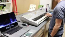 Image: man with smartwatch playing piano; Copyright: Carnegie Mellon University