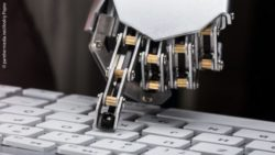 Image:  robot hand taps on a computer keyboard; Copyright: panthermedia.net/Andriy Popov