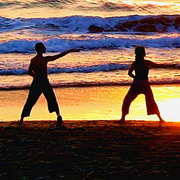 Photo: Two people doing tai chi