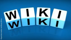 "Photo: Four blocks with the letters for the word ""Wiki"" on them"