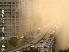 Photo: Motorway in a city covered by smog