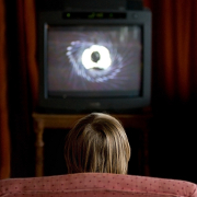 Photo: Child in front of TV