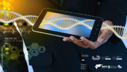 Image: Abstract picurtre of DNA. A part of the DNA can be seen in a smartphone; Copyright: panthermedia.net/brijit vijayan
