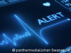 "Graphic: Monitor with ECG and word ""alarm"" next to it"