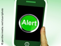 Graphic: Smart phone showing an alarm icon
