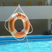Photo: Life belt hanging next to a pool