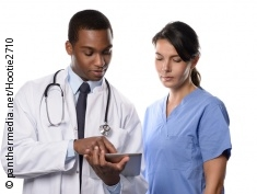 Photo: Doctor and nurse look at a tablet