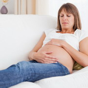 Photo: Pregnant woman lying on a sofa