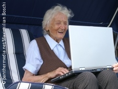 Photo: Elderly woman with a laptop