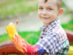 Photo: Boy with a colorful cast around the arm