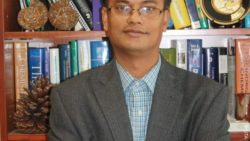 Image: smiling man in an office - Subhrangsu Mandal, UTA associate professor of chemistry; Copyright: UTA