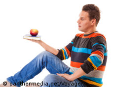 Photo: Man balancing an apple on a book