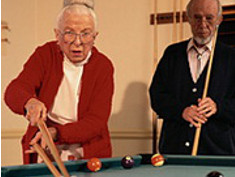 Photo: Elderly persons playing billard