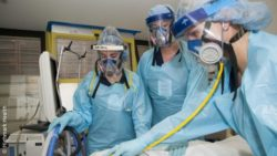 Image: health care workers with elastomeric masks; Copyright: Highmark Health