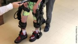 Image: gait training in robotic exoskeleton; Copyright: Kessler Foundation