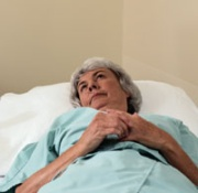 Photo: An elderly woman being examined