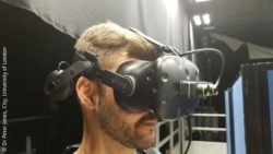 Image: researcher wearing VR device; Copyright: Dr Peter Jones, City, University of London