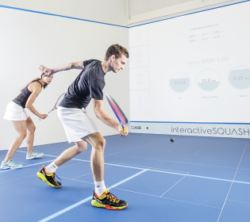 Photo: A man and a woman are playing squash - Copyright: InteractiveSQUASH