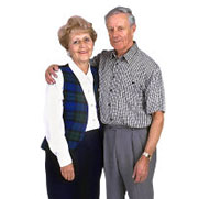 Photo: senior couple standing arm in arm