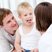 Photo: Doctor looks into the mouth of a child