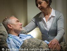 Photo: Older couple, the woman cares for the man