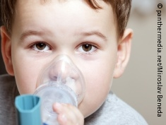 Photo: little boy with inhaler
