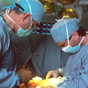 Photo: Two surgeons at work