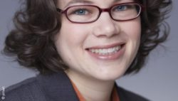 Photo: Young woman with short black hair and glasses - Dr. Kathrin Doppler; Copyright: privat