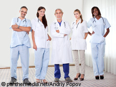 Photo: Doctors in scrubs and white coats