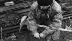 Image: Black and white picture of an old mineworker; Copyright: panthermedia.net/Tinatin1