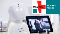 Image: small robot and tablet with logo of the MEDICA HEALTH IT FORUM