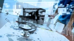 Image: Stethoscope lying on a world map and transparent icons placed over the entire image; Copyright: panthermedia.net/everythingposs