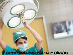 Photo: An OR nurse directs a lamp