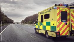 Image: An ambulance is driving on a long, wet motorway; Copyright: panthermedia.net/BrianAJackson