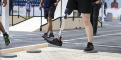 Photo: man with leg prosthesis takes an obstacle course