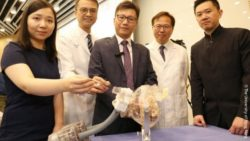 Photo: A HKU mechanical engineering team in front of their hydraulic-driven neurosurgical robotic system; Copyright: The University of Hong Kong