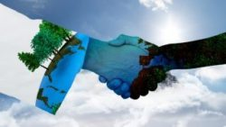 Image: Two arms shaking hands. Both hands and the right arm are painted like the earth. The background is a blue sky with white clouds; Copyright: panthermedia.net/WavebreakmediaLtd
