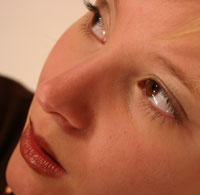 Photo: Woman's face with focus on nose