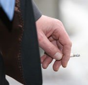 Picture: A hand holding a cigarette