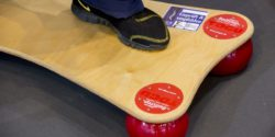 Image: One foot on a balance board; Copyright: Messe Düsseldorf