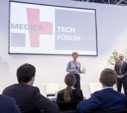 Image: A man and a woman on the stage of MEDICA TECH FORUM