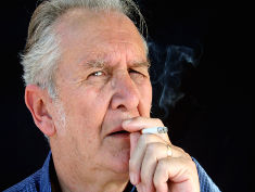 Photo: Older man smoking