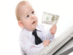 Photo: Baby in a suit holding a dollar