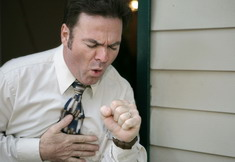 Photo: Man coughing