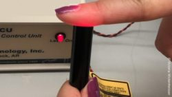 Image: External low-power laser pressed against a person's finger; Copyright: Victoria Wickenheisser