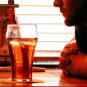 Photo: A man sitting in front of a glass of cold coke