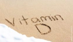 "Image: beach with the word ""Vitamin D"" written in the sand; Copyright: panthermedia.net/jaykal"
