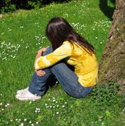 Picture: A lonely young woman sitting in a park