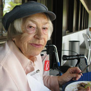 Photo: Older woman during lunch
