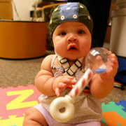 Photo: A baby with a cap fitted with electrodes